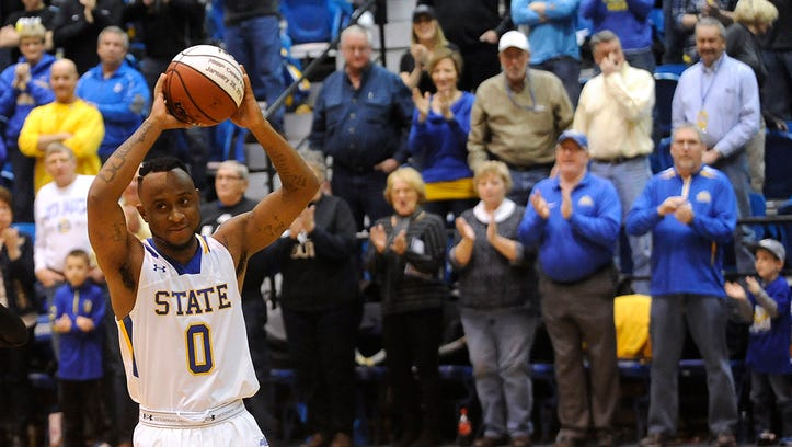 SDSU's #0 Deondre Parks receives a basketball for his 2,000 career points before the game against IUPUI at Frost Arena in Brookings, S.D., Saturday, Feb. 6, 2016.