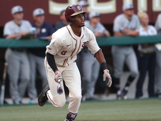 FSU's J.C. Flowers takes off for first base against Notre Dame during the Seminoles' 8-7 loss at Dick Howser Stadium on Friday, March 16, 2018.