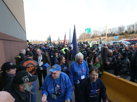 A large crowd of supporters show their support for veterans participating in the Hudson Valley Honor Flight on April 14, 2018 at Stewart Airport.