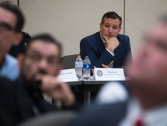 U.S. Senators Ted Cruz listens to a presentation during