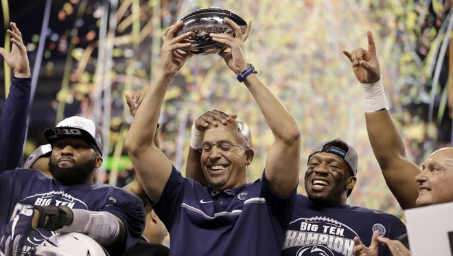 Penn State coach James Franklin holds the trophy after winning the Big Ten championship on Saturday. P.O. columnist Graham Messner argues that the Rose Bowl is actually a good fit for these Nittany Lions.