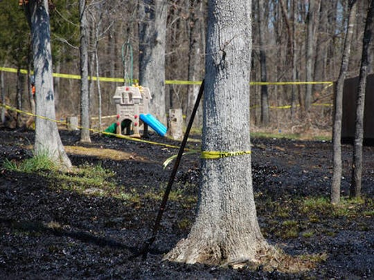 FILE - In this Monday, April 1, 2013 file photo, oil covers the ground around a slide in Mayflower, Ark., days after a pipeline ruptured and spewed oil over lawns and roadways. Exxon Mobil denied claims from plaintiffs in an oil spill lawsuit that it made all information about the maintenance and repair of an oil pipeline secret. President-elect Donald Trump announced Tuesday, Dec. 13, 2016, he has tapped ExxonMobil CEO Rex Tillerson to serve as his secretary of state. If confirmed by the Senate, where opposition is emerging, the move could have broad consequences for U.S. environmental policy and affect the role the U.S. plays in multinational discussions about climate change.