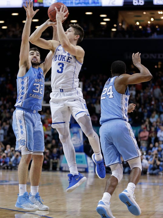 Duke guard Grayson Allen (3) puts up a three-point shot in the closing seconds of an NCAA college basketball game against North Carolina in the Atlantic Coast Conference men's tournament Friday, March 9, 2018, in New York. North Carolina won 74-69. (AP Photo/Julie Jacobson)