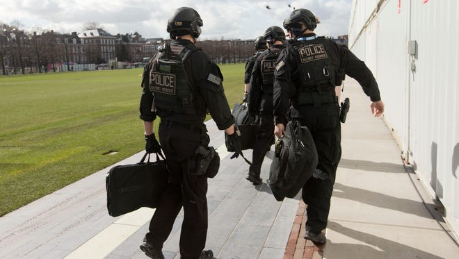 "Members of the U.S. Secret Service's Counter Assault Team, known in the agency as CAT, are seen before boarding helicopters at a landing zone in Rijksmuseum in Amsterdam on March 24, 2014. The Secret Service sent three agents home from the Netherlands just before Obama's arrival after one agent was found inebriated in an Amsterdam hotel, the Secret Service said Tuesday. The three agents were benched for ""disciplinary reasons,"" said Secret Service spokesman Ed Donovan, declining to elaborate."