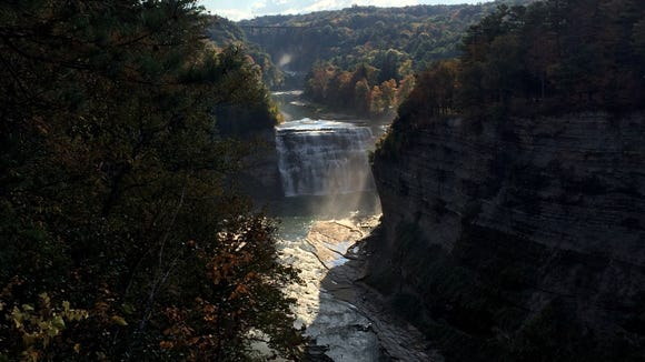 Looking up the Genesee River gorge toward the Middle Falls and the railroad trestle in Letchworth State Park.