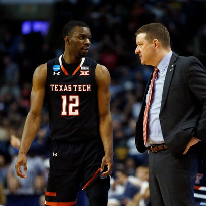 Texas Tech guard Keenan Evans and coach Chris Beard