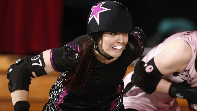 Dolls of Anarchy jammer Yvette Massinger during a past Cherry City Derby Girls bout.