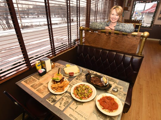 Michelle Greer, owner of Chelo's Pizzeria in McConnelsville, with some of the restaurant's extensive menu offerings.