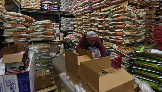 Cliff Cook works in the warehouse at Orscheln Farm and Home in Mountain Home on Wednesday in preparation for Black Friday. Preparing for Black Friday begins months in advance and runs right up until the popular shopping day.
