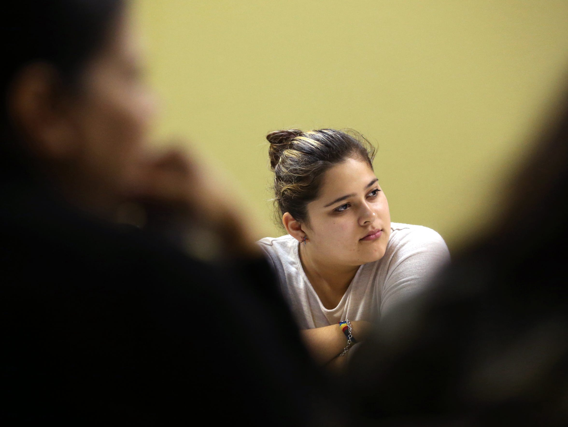 "Claudia Jimenez, 19, attends a bible study class at Holy Family Catholic Church on November 5, 2017. ""I'm just like everyone else, I'm no different,"" she said. ""I'm not going to harm you just because I am illegal. I didn't come here to harm anybody. I came here, my family came here to make something better of myself."""