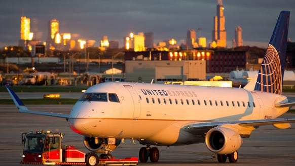 An Embraer E170/75 gets a tow across Chicago O'Hare