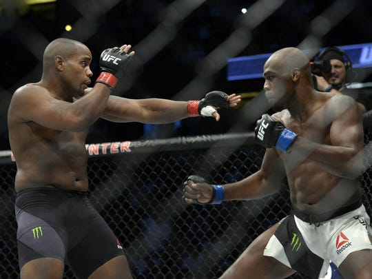 Daniel Cormier defends as Jon Jones moves in for a hit during UFC 214 at Honda Center in Anaheim, California, on Saturday.