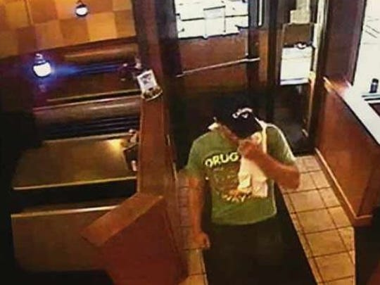 Video still showing a robbery suspect