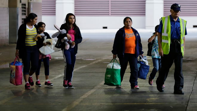 In this July 7, 2015, file photo, immigrants from El Salvador and Guatemala who entered the country illegally board a bus after they were released from a family detention center in San Antonio. Justice Department lawyers are asking a federal judge to reconsider her July ruling ordering the release of children and mothers detained after they entered the U.S. illegally across the Mexican border.
