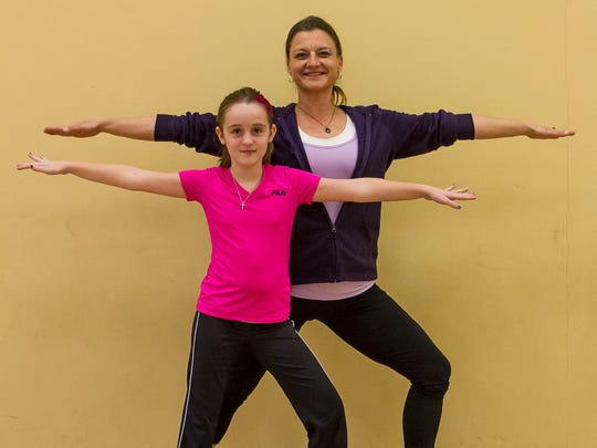 Jennifer Jones of East Brunswick, who struggles with Reflex Sympathetic Dystrophy Syndrome, has gone from being bedridden for a decade to working as a health and wellness coach at the Raritan Valley YMCA in East Brunswick. With Jones is Emily Case of Spotswood, 10, who also has RSDS.