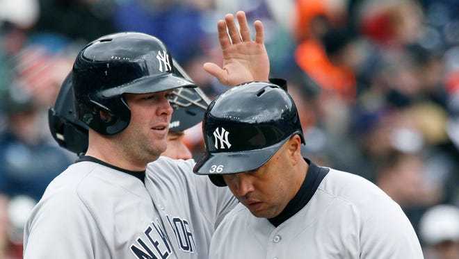 New York Yankees' Carlos Beltran, right, is congratulated by Brian McCann after hitting a two-run home run against the Detroit Tigers Brian McCann of a baseball game Saturday, April 9, 2016, in Detroit. The Yankees defeated the Tigers 8-4.