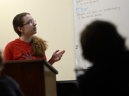 Kaitlyn Holzer gives a presentation inside her AP human geography class at Green Bay East High School.