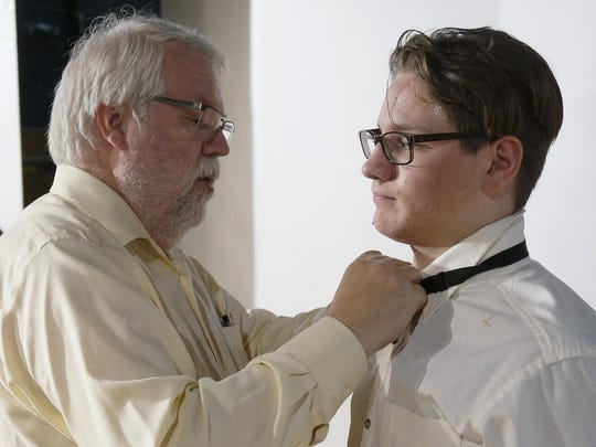 Drama teacher Michael Corliss helps Dante Lamb with
