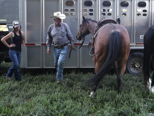 Nellie Miller, left, and her dad Sam Williams, get her horses ready in Cottonwood.