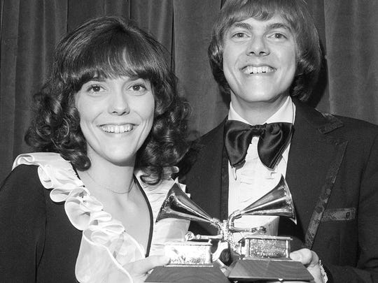 In this March 14, 1972 file photo, siblings Karen and Richard Carpenter of the vocal duo Carpenters pose with their Grammys for best pop vocal performance by a group.
