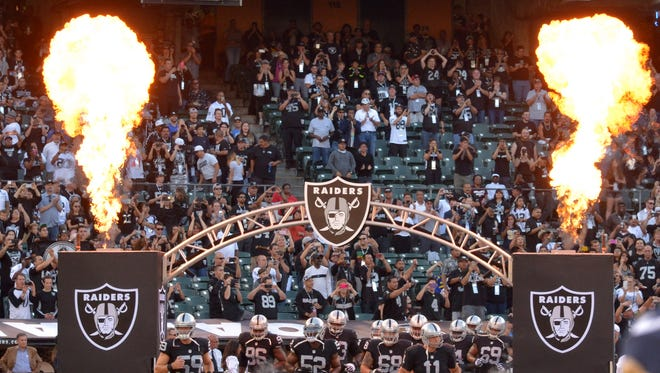 The Oakland Raiders take the field at O.co Coliseum.