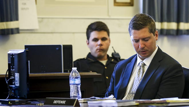 Ray Tensing, the former University of Cincinnati police officer, listens to Assistant Prosecutor Stacey DeGraffenreid present closing arguments on the eighth day of Raymond Tensing's retrial in Hamilton County Common Pleas Judge Leslie Ghiz's courtroom Monday, June 19, 2017.