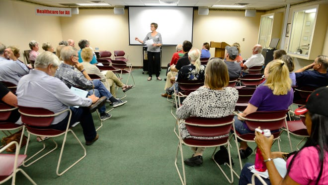 Josie Setzler, chairperson of Sandusky County Citizens for Affordable Healthcare, speaks at a forum about health care at the Birchard Library Tuesday evening.