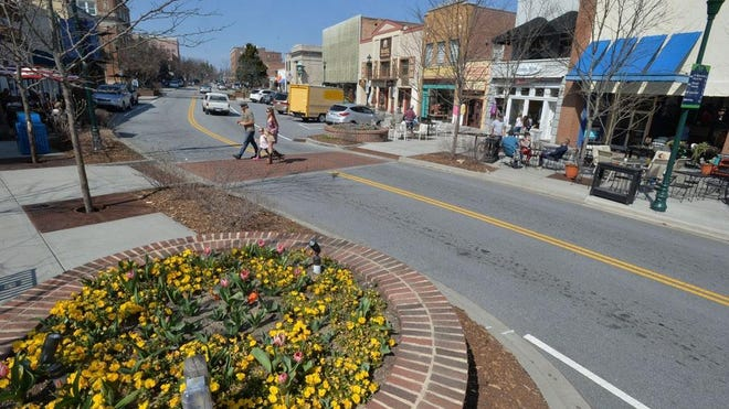 Downtown Hendersonville is launching LoveHendo-Shop Local Saturdays to provide open-air activity on Main Street, shown here, the first Saturday of each month.