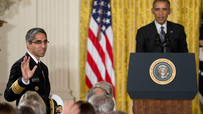 Surgeon General Vivek H. Murthy with President Obama in the East Room of the White House in Washington on Jan. 30, 2015, where the president called for an investment to move away from one-size-fits-all-medicine toward an approach that tailors treatment to your genes.