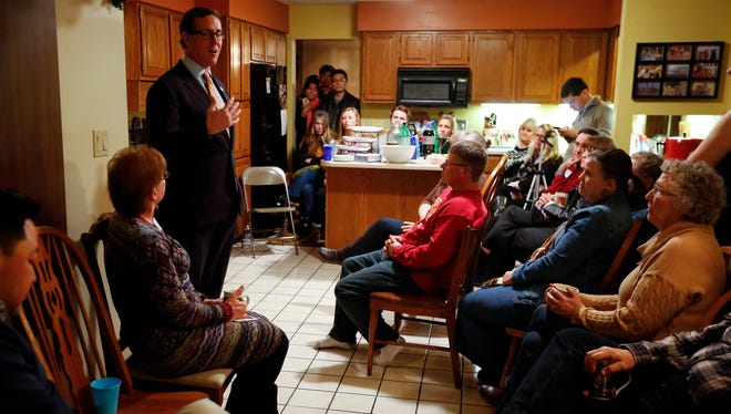 Republican presidential candidate Rick Santorum speaks at a house party in Urbandale, Iowa, Thursday, Jan. 7, 2016.