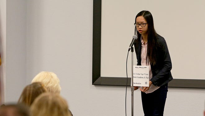 Celine Yap, an eighth-grader at Christ Academy Junior High, participates in the practice round of the 33rd Annual Regional Spelling Bee Saturday morning at the Region 9 Education Services Center.