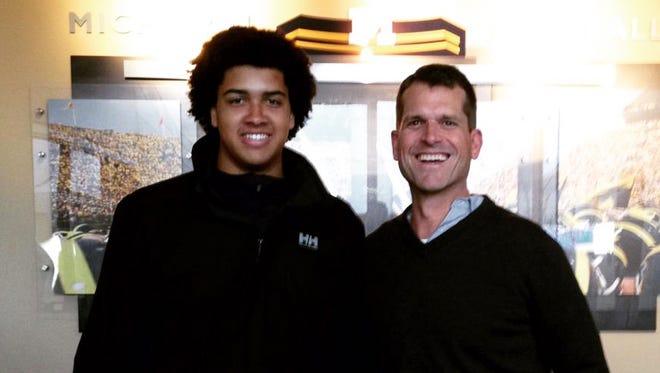 Devery Hamilton with Michigan coach Jim Harbaugh.