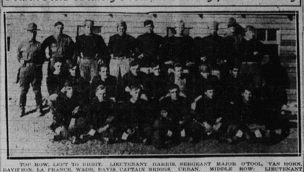 A clipping from 1915: The Fourth Field Artillery football team was ready for the New Year's game against the 11th Cavalry.