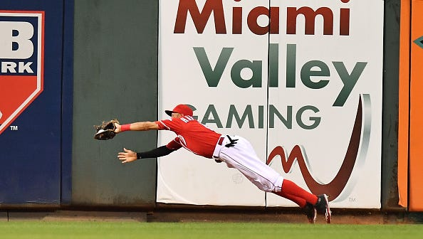 Billy Hamilton makes a diving catch in center field in the sixth inning of Tuesday's 3-0 win over the Rangers.