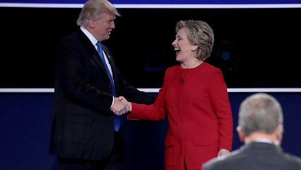 Republican presidential nominee Donald Trump and Democratic presidential nominee Hillary Clinton shake hands after the Presidential Debate at Hofstra University on September 26, 2016.
