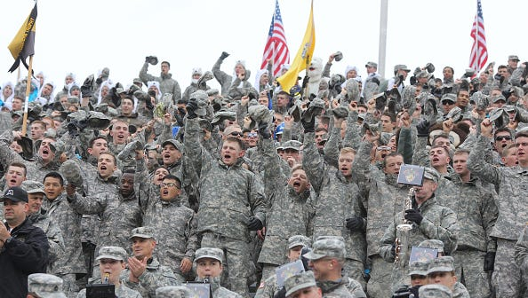 Army personnel take in an Army football game at Michie Stadium on the U.S. Military Academy campus.