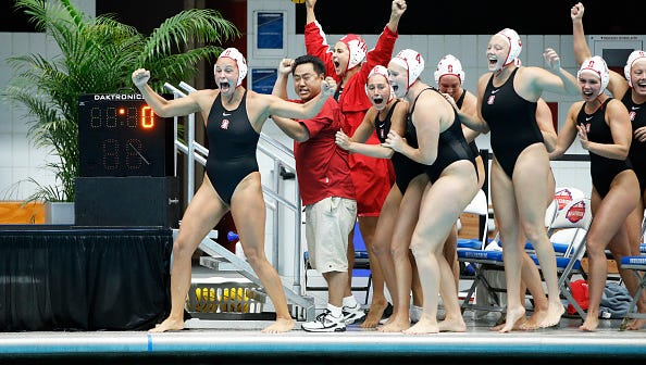 Okemos grad Katie Dudley, (center, No. 4), helped Stanford capture its fifth women's water polo national title in seven years over the weekend.