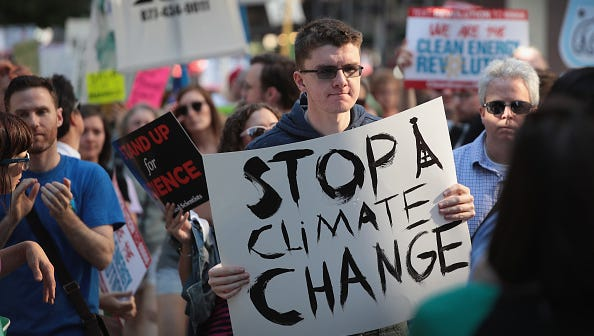 CHICAGO, IL - JUNE 02:  Demonstrators protest President Donald Trump's decision to exit the Paris climate change accord on June 2, 2017 in Chicago, Illinois.  Yesterday, in a speech from the Rose Garden, Trump announced that the United States would no longer honor the agreement, stating it imposed unfair standards on American businesses and workers.  (Photo by Scott Olson/Getty Images)
