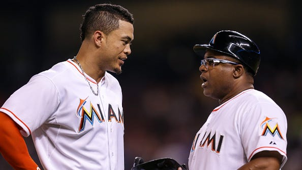 Former Miami Marlins player and third base coach Lenny Harris (right) shown with former Marlins star Giancarlo Stanton, will be part of the Pensacola Blue Wahoos coaching staff for the 2018 season as the team's bench coach.
