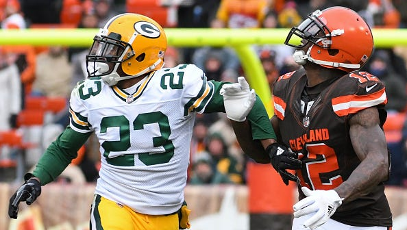 CLEVELAND, OH - DECEMBER 10, 2017: Wide receiver Josh Gordon #12 of the Cleveland Browns and cornerback Damarious Randall #23 of the Green Bay Packers engage as they run downfield in the third quarter of a game on December 10, 2017 at FirstEnergy Stadium in Cleveland, Ohio. Green Bay won 27-21 in overtime. (Photo by: 2017 Nick Cammett/Diamond Images/Getty Images)