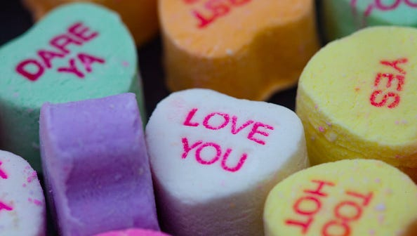 Valentines Day candy in the shape of hearts with messages of love and friendship on them, known as conversation candy avaible before Valentines Day. (Photo by Julie Dermansky/Corbis via Getty Images)