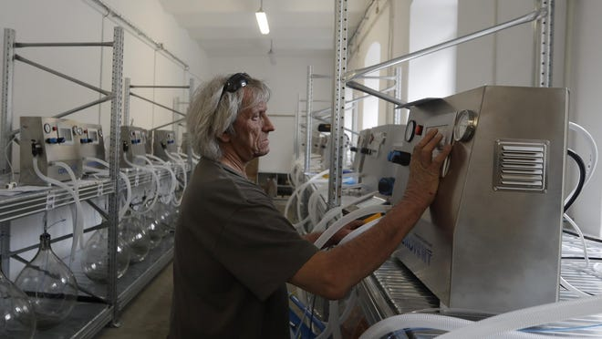 A worker checks a lung ventilator named Corovent and manufactured in Trebic, Czech Republic. A group of volunteers was working round the clock to prevent a critical shortage of ventilators for COVID-19 patients.