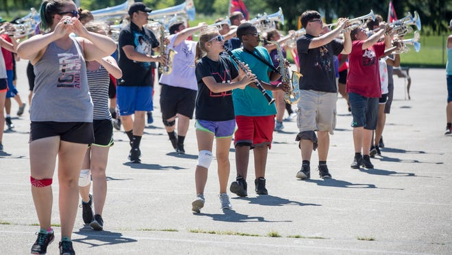 Muncie Central's band practices their show on July 25 in preparation for two weekends of competitions. This is Central's first competition year under the direction of Eric Bowman.
