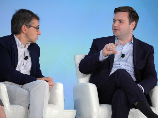 """Ian Bremmer, a global analyst, and J.D. Vance, venture capitalist and """"Hillbilly Elegy"""" author, speak during a panel discussion Monday, Nov. 13, 2017, at the Global Financial Leadership Conference at The Ritz-Carlton Beach Resort in North Naples."""