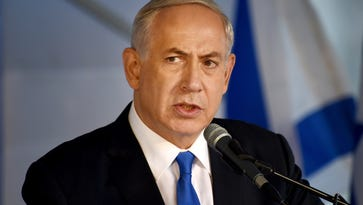 Israeli Prime Minister Benjamin Netanyahu speaks during the official memorial ceremony marking the 20th anniversary of the assassination of the late Prime Minister Yitzhak Rabin in the Mt. Herzl Cemetery in Jerusalem on Oct. 26, 2015.