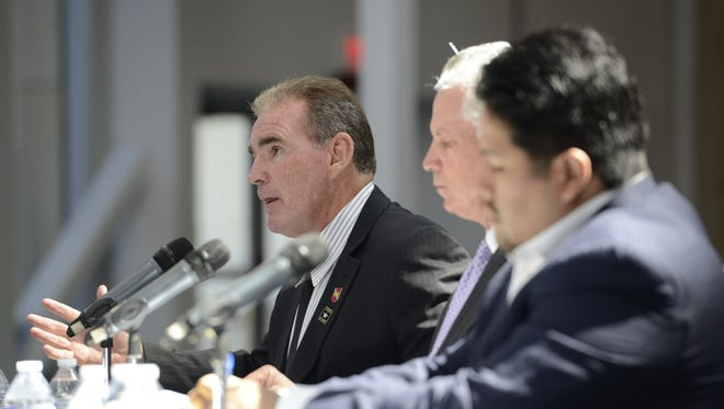 Joseph Callahan, left, speaks Monday during a Congressional Field Hearing about Hezbollah gains in South America at the National Naval Aviation Museum in Pensacola.
