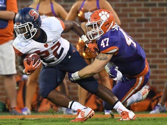 Clemson linebacker James Skalski (47) brings down Syracuse