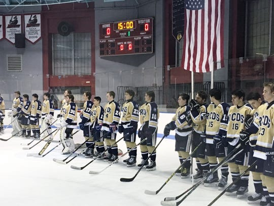 RCDS hockey stands for pregame ceremony prior to Wednesday's game against Rye.