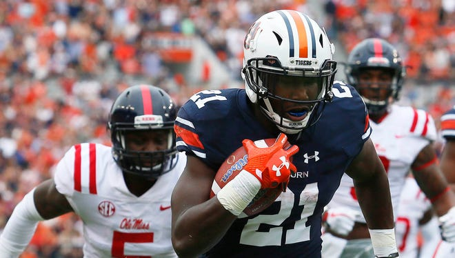 Auburn Tigers running back Kerryon Johnson  scores a touchdown against the Ole Miss Rebels during the first quarter at Jordan-Hare Stadium.