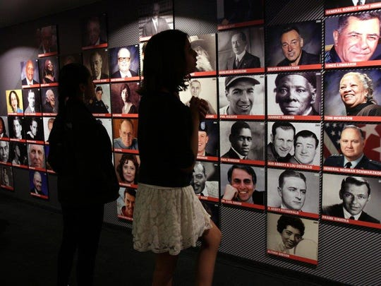 Visitors tour the New Jersey Hall of Fame Mobile Museum.